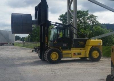 Web hoist forklift moving a coil 12